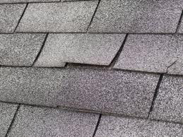 wind damage to shingles in winchester ky