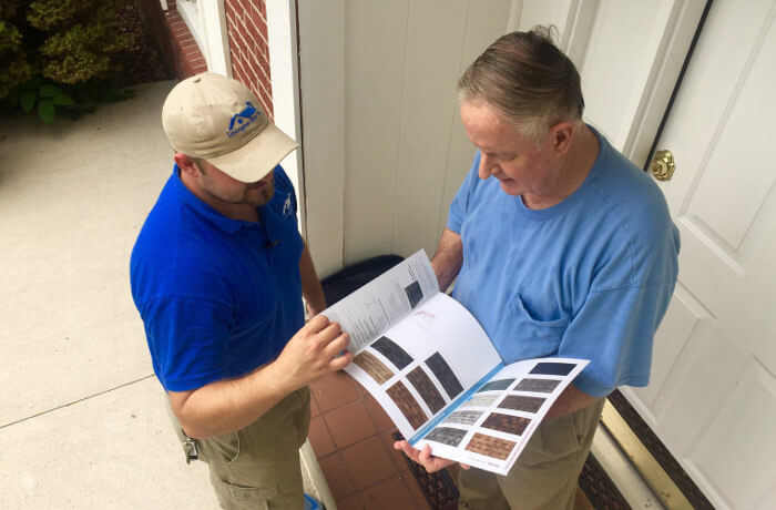 lexington blue team member assisting client with shingle color selection