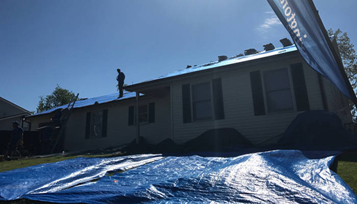 protecting yard from roof debris with tarps 5-19-17