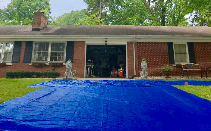 tarp in yard to catch roofing debris 7-22-17