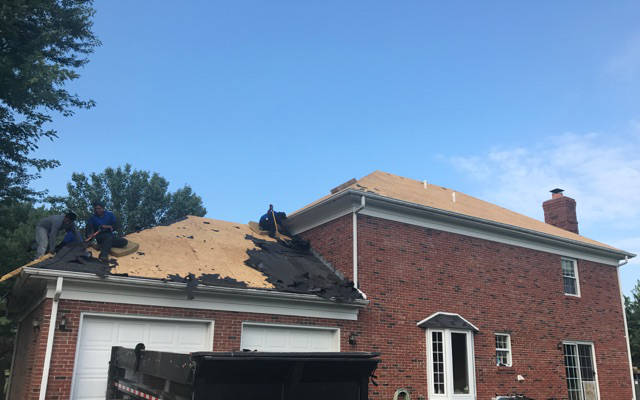 roofers tearing off old roofing material 8-25-17