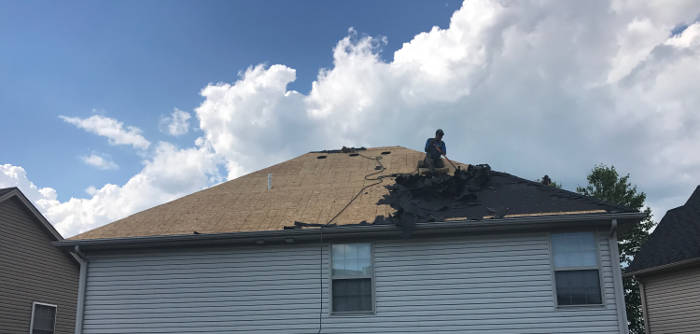 completely removing all old roofing materials