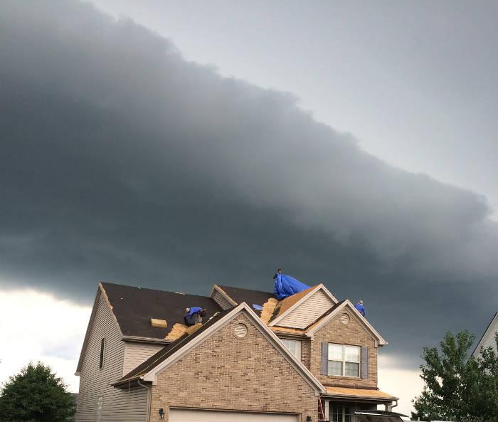 tarping off roof before rain storm lexington ky