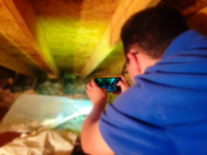 inspecting rafters insulation in attic