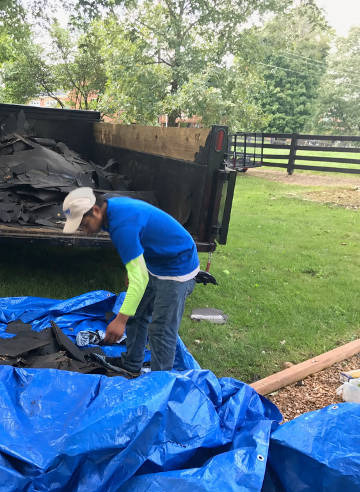 loading the old roofing debris in trailer 9-25-17