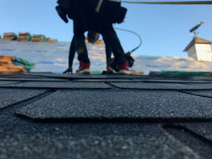 roofers installing new shingles 9-25-17