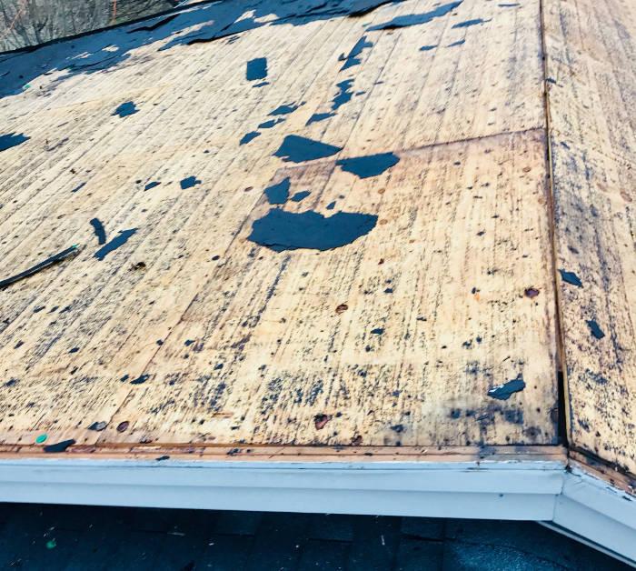 partial roofing felt still on roof