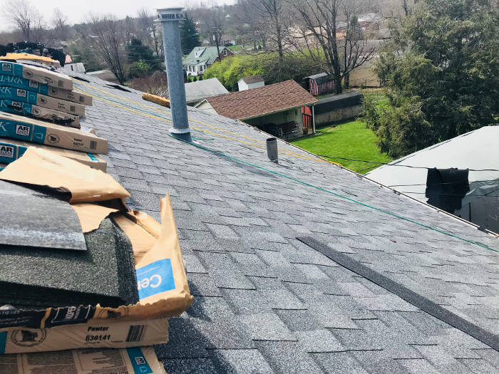 shingle installation halfway completed 4-6