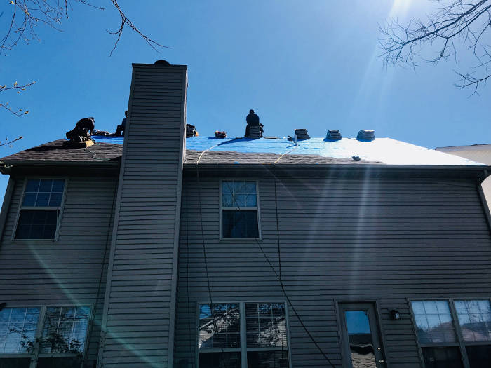 our crew installing shingles on back side of home 4-20