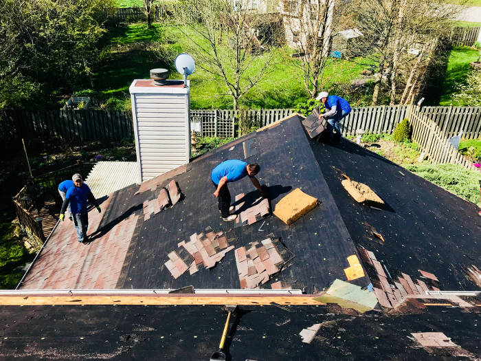 tearing off old shingles 4-27