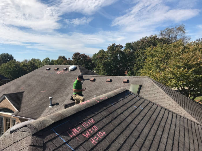 insurance adjuster inspecting roof